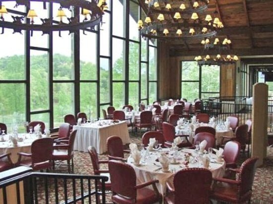 The Kingwood Dining Room with lots of tables and fancy chandeliers