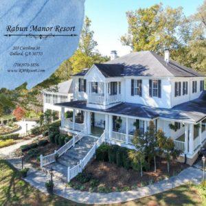 """Exterior shot of Rabun Manor Resort with Text: """"Rabun Manor Resort, 205 Carolina St, Dillard, GA 30753, (706)970-1856, www.RMResort.com"""