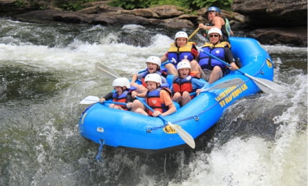 A family goes river rafting.