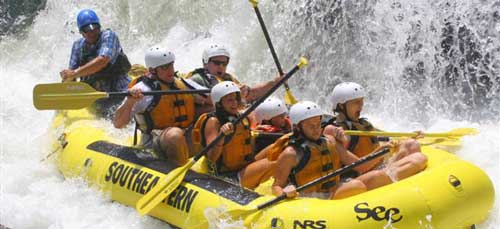 A group goes white water rafting.